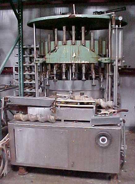 30 Head US BOTTLERS Rotary Vacuum Filler